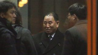 Kim Yong Chol (C), a North Korean senior ruling party official and former intelligence chief, arrives at the airport in Beijing to leave for Washington on January 17, 2019. - The top North Korean official left for Washington on January 17, reports said, for talks with his US counterpart ahead of an expected summit between President Donald Trump and Pyongyang's leader Kim Jong Un. (Photo by YONHAP / YONHAP / AFP) / - South Korea OUT / REPUBLIC OF KOREA OUT  NO ARCHIVES  RESTRICTED TO SUBSCRIPTION USE