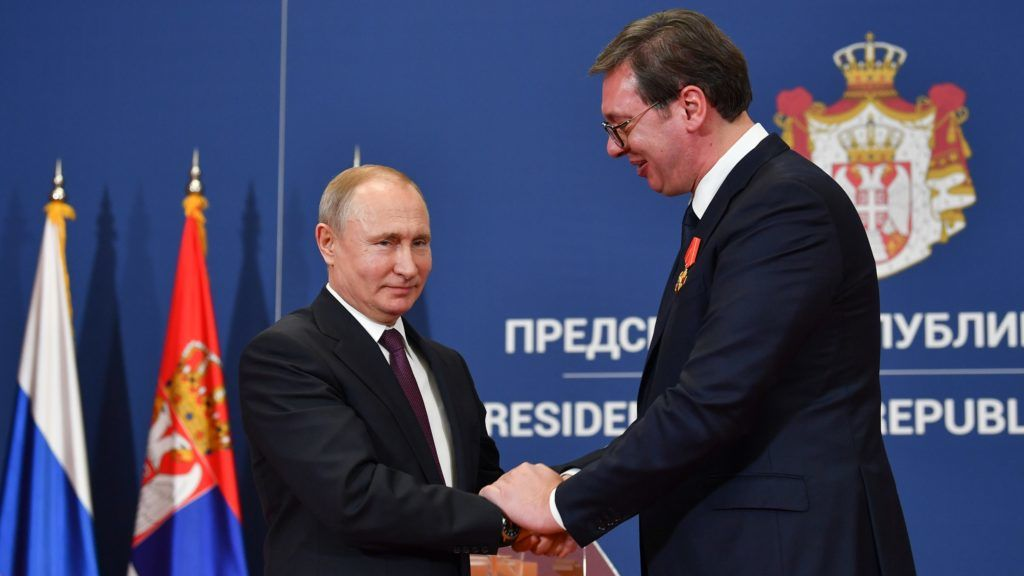 Russian President Vladimir Putin decorates Serbian President Aleksandar Vucic with the Alexander Nevsky Order following a signing ceremony after their talks in Belgrade on January 17, 2019. (Photo by Andrej ISAKOVIC / AFP)