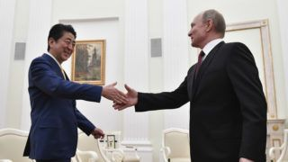 Russian President Vladimir Putin (R) shakes hands with Japanese Prime Minister Shinzo Abe during a meeting at the Kremlin in Moscow on January 22, 2019. (Photo by Alexander NEMENOV / POOL / AFP)