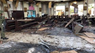 """This handout photo released by Armed Forces of the Philippines (AFP) Public Information Office (PIO) Western Mindanao Command (WESTMINCON) taken on January 27, 2019, shows debris inside a Catholic Church where two bombs exploded in Jolo, Sulu province on the southern island of Mindanao. - At least 17 people were killed as two bombs hit a church on a southern Philippine island that is a stronghold of Islamist militants, the military said, just days after a regional vote for a new Muslim autonomous region. The first blast occurred inside the Catholic church on war-torn Jolo on Sunday morning as mass was being celebrated, and was followed by a second explosion in the parking lot as troops responded, regional military spokesman Lieutenant Colonel Gerry Besana told AFP. (Photo by HANDOUT / AFP) / RESTRICTED TO EDITORIAL USE - MANDATORY CREDIT """"AFP PHOTO - ARMED FORCES OF THE PHILIPPINES, WESTERN MINDANAO COMMAND"""" - NO MARKETING NO ADVERTISING CAMPAIGNS - DISTRIBUTED AS A SERVICE TO CLIENTS"""