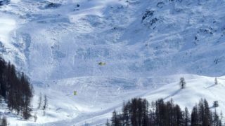 Rescue forces are seen at work in the area of the Jochgrubkopf peak in Tyrol, Austria on March 15, 2017. - As many as four skiers were feared dead on March 15, 2017 after an avalanche engulfed a tour party of eight people in western Austria, police said. (Photo by - / various sources / AFP) / Austria OUT