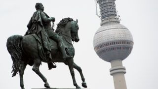 FILED - 24 April 2018, Germany, Berlin:†The statue of Frederick William IV at the Alte Nationalgalerie (L). The TV tower can be seen in the background. Photo: Lisa Ducret/dpa