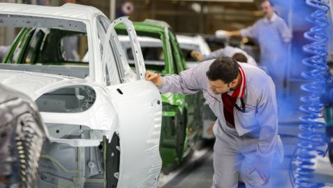 13 December 2018, Saxony, Leipzig: An employee checks the paint on the body of a Porsche Macan in the paint shop at the Leipzig plant. The car manufacturer Porsche is preparing for the future of electric cars at its Leipzig location. Even though the long-awaited decision to build an electrically powered Macan is still pending, it is clear that the next generation of the small off-road Macan will be built in Leipzig. The foundation stone for a new body shop is to be laid in spring. Porsche is planning investments in the three-digit million range at its Saxon location with more than 4200 employees. Photo: Jan Woitas/dpa-Zentralbild/dpa