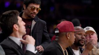 LOS ANGELES, CALIFORNIA - JANUARY 21: Manny Pacquiao greets Floyd Mayweather Jr. as he passes by during the game between the Golden State Warriors and the Los Angeles Lakers at Staples Center on January 21, 2019 in Los Angeles, California. NOTE TO USER: User expressly acknowledges and agrees that, by downloading and or using this photograph, User is consenting to the terms and conditions of the Getty Images License Agreement.   Harry How/Getty Images/AFP