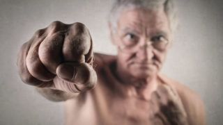Old man without T-shirt looks very brave
