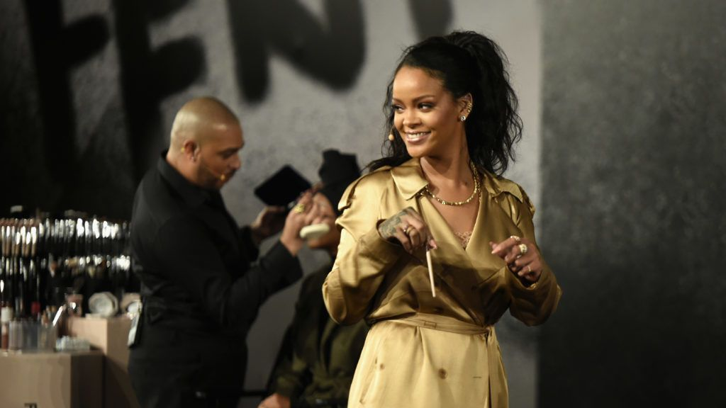 """DUBAI, UNITED ARAB EMIRATES - SEPTEMBER 29:  Rihanna walks on stage during her Fenty Beauty talk in collaboration with Sephora, for the launch of her new Stunna Lip paint """"Uninvited"""" on September 29, 2018 in Dubai, United Arab Emirates.  (Photo by Mark Ganzon/Getty Images for Fenty Beauty)"""