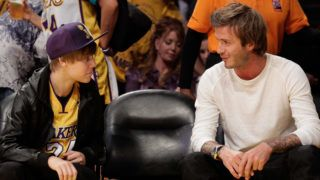 LOS ANGELES, CA - OCTOBER 26:  Justin Bieber (L) and David Beckham attend a game between the Houston Rockets and the Los Angeles Lakers at Staples Center on October 26, 2010 in Los Angeles, California.  (Photo by Noel Vasquez/Getty Images)