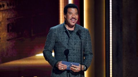 NASHVILLE, TN - NOVEMBER 14:  (FOR EDITORIAL USE ONLY) Singer-songwriter Lionel Richie speaks onstage during the 52nd annual CMA Awards at the Bridgestone Arena on November 14, 2018 in Nashville, Tennessee.  (Photo by Erika Goldring/WireImage,)
