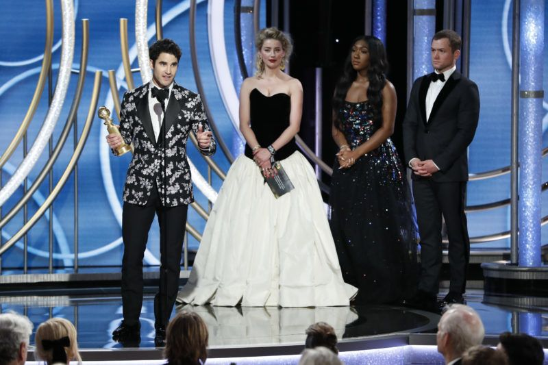 """BEVERLY HILLS, CALIFORNIA - JANUARY 06: In this handout photo provided by NBCUniversal, Darren Criss from """"The Assassination of Gianni Versace: American Crime Story"""" accepts the Best Performance by an Actor in a Limited Series or Motion Picture Made for Television award onstage during the 76th Annual Golden Globe Awards at The Beverly Hilton Hotel on January 06, 2019 in Beverly Hills, California.  (Photo by Paul Drinkwater/NBCUniversal via Getty Images)"""