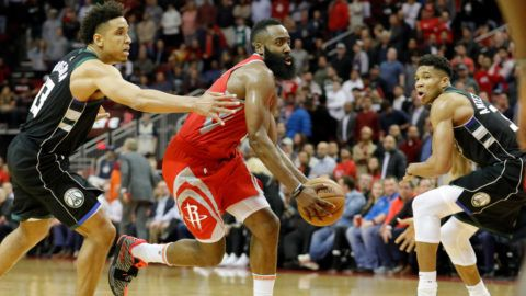 HOUSTON, TX - JANUARY 09:  James Harden #13 of the Houston Rockets drives to the basket defended by Giannis Antetokounmpo #34 of the Milwaukee Bucks and Malcolm Brogdon #13 in the second half at Toyota Center on January 9, 2019 in Houston, Texas.  NOTE TO USER: User expressly acknowledges and agrees that, by downloading and or using this photograph, User is consenting to the terms and conditions of the Getty Images License Agreement.  (Photo by Tim Warner/Getty Images)