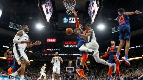SAN ANTONIO, TX - JANUARY 10:  DeMar DeRozan #10 of the San Antonio Spurs passe the ball to LaMarcus Aldridge #12  after being cut off by Steven Adams #12 of the Oklahoma City Thunder at AT&T Center on January 10, 2019 in San Antonio, Texas.  NOTE TO USER: User expressly acknowledges and agrees that , by downloading and or using this photograph, User is consenting to the terms and conditions of the Getty Images License Agreement. (Photo by Ronald Cortes/Getty Images)