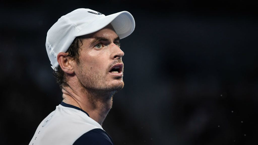 MELBOURNE, AUSTRALIA - JANUARY 14: Andy Murray of Great Britain reacts in his first round match against Roberto Bautista Agut of Spain during day one of the 2019 Australian Open at Melbourne Park on January 14, 2019 in Melbourne, Australia.(Photo by Fred Lee/Getty Images)