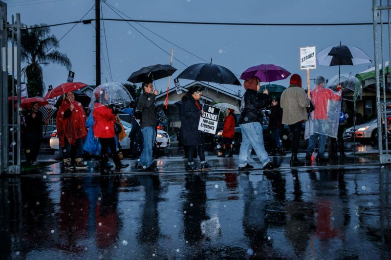 LOS ANGELES, CA - JANUARY 14: Educators and their supporters participate in the UTLA teacher's strike outside of Roosevelt High School as they walk off the job in their first strike in 30 years to demand smaller class sizes, more support staff at schools and better pay, on January 14, 2019 in Los Angeles, California. (Photo by Marcus Yam/Los Angeles Times via Getty Images)