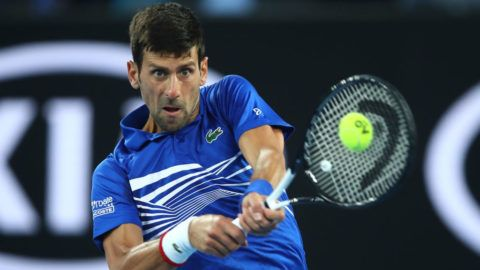 MELBOURNE, AUSTRALIA - JANUARY 23:  Novak Djokovic of Serbia plays a backhand in his quarter final match against Kei Nishikori of Japan during day 10 of the 2019 Australian Open at Melbourne Park on January 23, 2019 in Melbourne, Australia.  (Photo by Julian Finney/Getty Images)