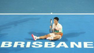 BRISBANE, AUSTRALIA - JANUARY 06: Kei Nishikori of Japan holds the winners trophy after the Men's Finals match against Daniil Medvedev of Russia during day eight of the 2019 Brisbane International at Pat Rafter Arena on January 06, 2019 in Brisbane, Australia. (Photo by Chris Hyde/Getty Images)