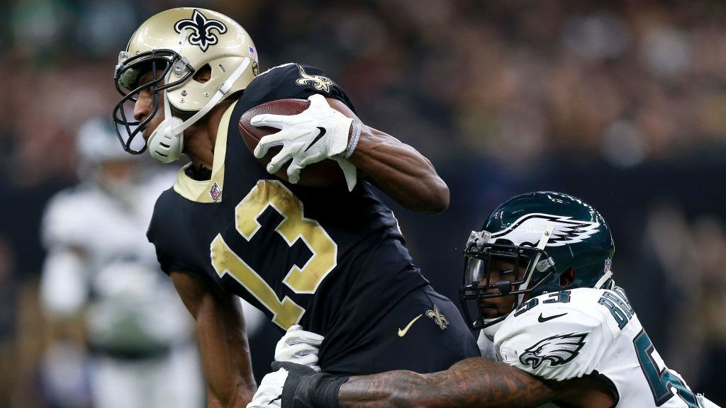 NEW ORLEANS, LOUISIANA - JANUARY 13:  Michael Thomas #13 of the New Orleans Saints is tackled by Nigel Bradham #53 of the Philadelphia Eagles during the second quarter in the NFC Divisional Playoff Game at Mercedes Benz Superdome on January 13, 2019 in New Orleans, Louisiana. (Photo by Sean Gardner/Getty Images)