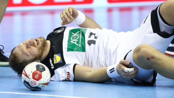 BERLIN, GERMANY - JANUARY 14: Steffen Weinhold of Germany lays injured during the 26th IHF Men's World Championship group A match between Russia and Germany at Mercedes-Benz Arena on January 14, 2019 in Berlin, Germany. (Photo by Martin Rose/Bongarts/Getty Images)
