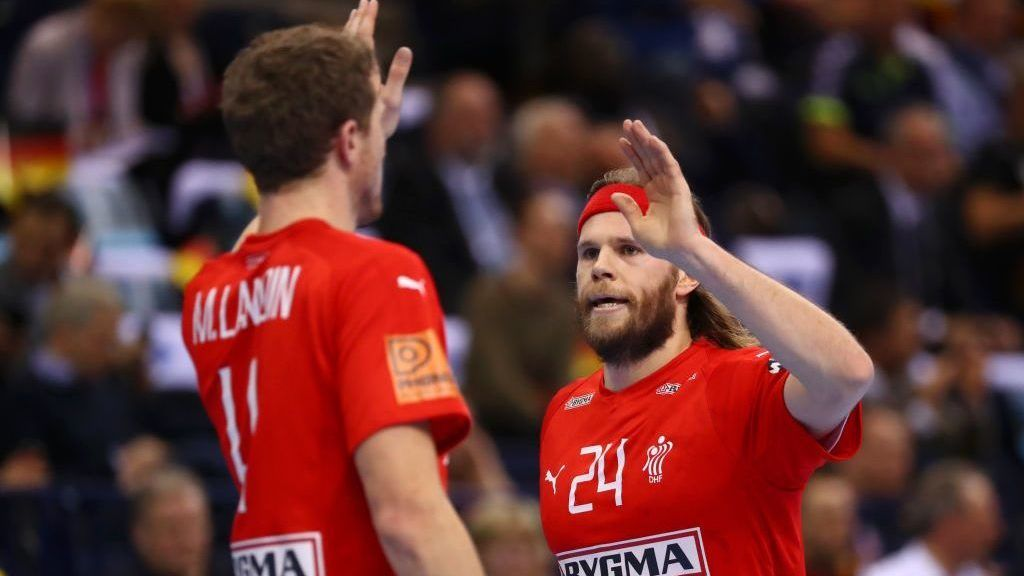 HAMBURG, GERMANY - JANUARY 25: Rasmus Lauge of Denmark and Mikkel Hansen of Denmark celebrates during the 26th IHF Men's World Championship semifinal between Denmark and France at Barclaycard Arena on January 25, 2019 in Hamburg, Germany. (Photo by Martin Rose/Bongarts/Getty Images)