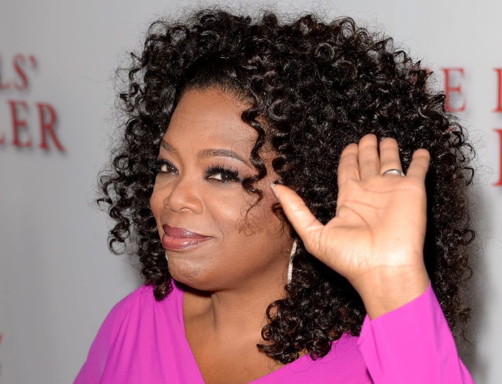 """LOS ANGELES, CA - AUGUST 12:  Oprah Winfrey arrives at the premiere of The Weinstein Company's """"Lee Daniels' The Butler"""" at Regal Cinemas L.A. Live on August 12, 2013 in Los Angeles, California.  (Photo by Jason Merritt/Getty Images)"""
