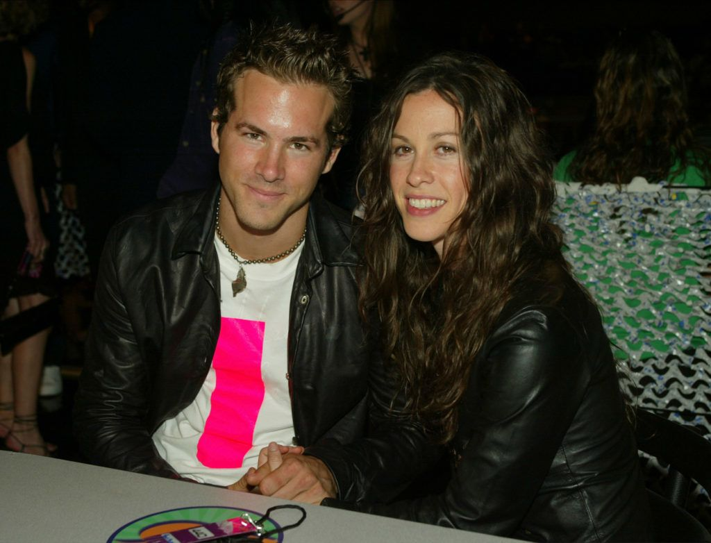 LOS ANGELES - MAY 31:  (U.S. TABS OUT)  Ryan Reynolds and Alanis Morissette pose backstage at The 2003 MTV Movie Awards held at the Shrine Auditorium on May 31, 2003 in Los Angeles, California. (Photo by Kevin Winter/Getty Images)