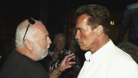 """LOS ANGELES - JUNE 30:  (U.S. TABS & HOLLYWOOD REPORTER OUT) Producer Andy Vajna (L) and actor Arnold Schwarzenegger talk at the after-party for """"Terminator 3: Rise of the Machines"""" at the Wadsworth Theater on June 30, 2003 in Los Angeles, California. (Photo by Kevin Winter/Getty Images)"""