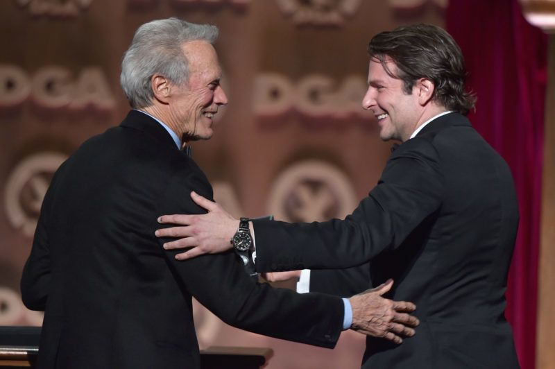 CENTURY CITY, CA - FEBRUARY 07:  Actor/director Clint Eastwood (L) accepts the Feature Film Nomination Plaque for ?American Sniper? from actor Bradley Cooper onstage at the 67th Annual Directors Guild Of America Awards at the Hyatt Regency Century Plaza on February 7, 2015 in Century City, California.  (Photo by Alberto E. Rodriguez/Getty Images for DGA)