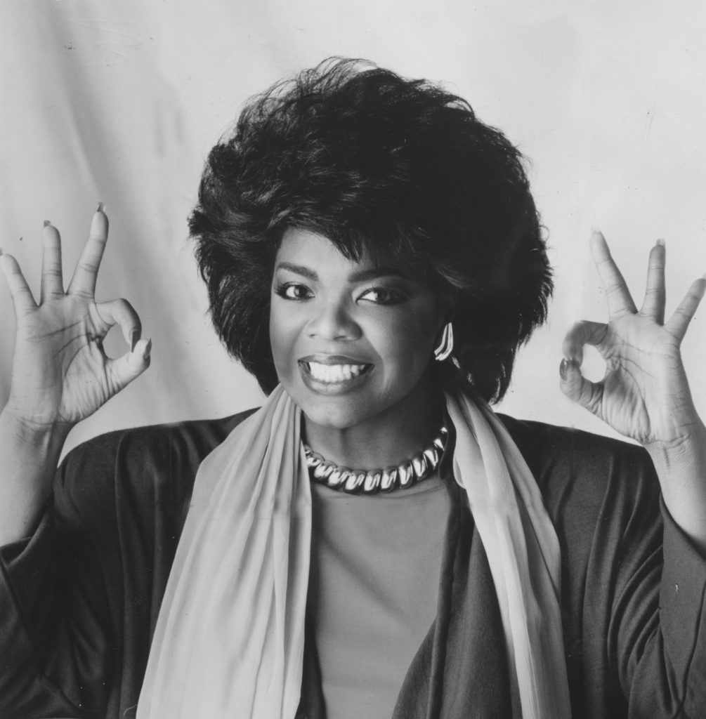 Oprah Winfrey smiles and gives the Okay sign during her time hosting the television show People Are Talking, 1978. (Photo by Afro American Newspapers/Gado/Getty Images)