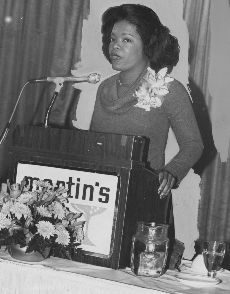 Oprah Winfrey speaks at a podium early in her career, during her time at WJZ, Baltimore, Maryland, January 20, 1978. (Photo by Afro American Newspapers/Gado/Getty Images)