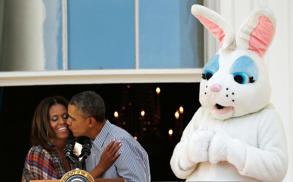 WASHINGTON, DC - APRIL 21:  U.S. President Barack Obama kisses first lady Michelle Obama at the annual White House Easter Egg Roll on the South Lawn April 21, 2014 in Washington, DC. President Obama and the first lady hosted thousands of children for the annual White House event dating back to 1876 that features live music, sports courts, cooking stations, storytelling, as well as the Easter egg roll this year.  (Photo by Win McNamee/Getty Images)