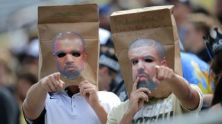 ORLANDO, FL - OCTOBER 24:  UCF fans wear bags with pictures of musicians Kanye West and Drake on them during an NCAA football game between the Houston Cougars and the UCF Knights at Bright House Networks Stadium on October 24, 2015 in Orlando, Florida. (Photo by Alex Menendez/Getty Images)