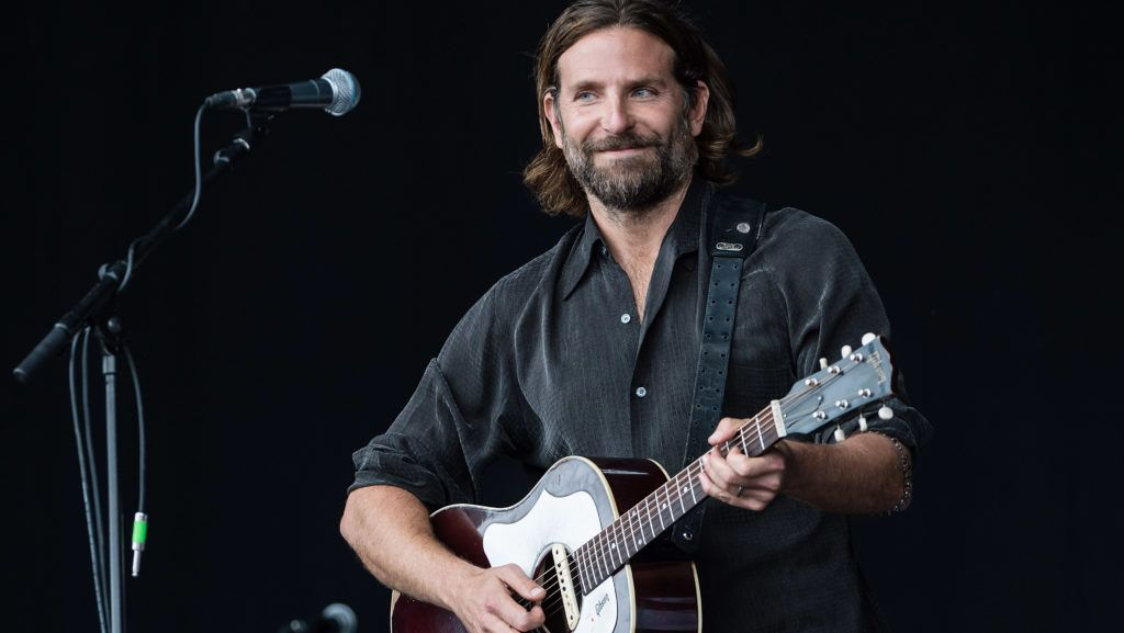 """GLASTONBURY, ENGLAND - JUNE 23:  Bradley Cooper performs on the Pyramid stage to shoot footage for a film called """"A Star Is Born"""" on day 2 of the Glastonbury Festival 2017 at Worthy Farm, Pilton on June 23, 2017 in Glastonbury, England.  (Photo by Ian Gavan/Getty Images)"""