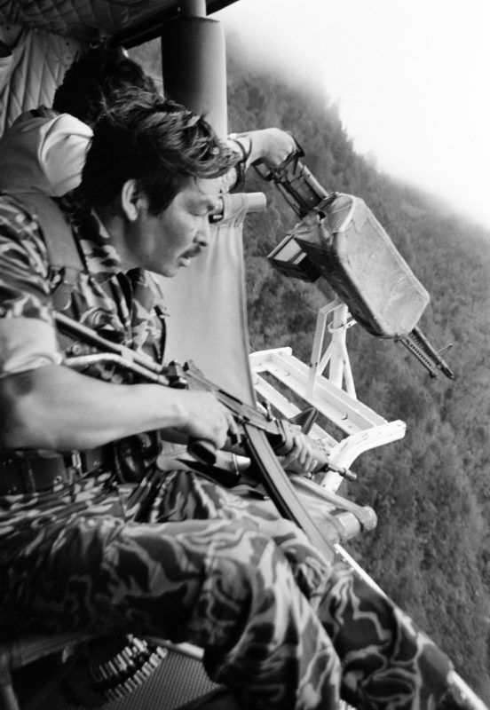 SANTA CRUZ DEL QUICHE, GUATEMALA - Army soldiers fire on local Mayan Indians from a US-made Bell helicopter flown by Guatemalan Army General Benedicto Lucas Garcia outside of Santa Cruz del QuichŽ, Guatemala, January 1, 1982. The army general claimed if the locals run from the army helicopter, they must be guilty of being guerrillas. (Photo by Robert Nickelsberg/Getty Images)