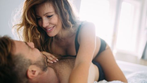 Attractive young couple sharing intimate moments in bedroom