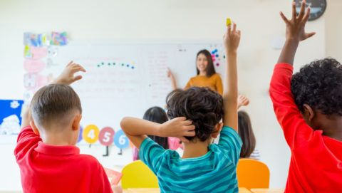 Image: 73846835, Preschool kid raise arm up to answer teacher question on whiteboard in classroom,Kindergarten education concept., Place: Hungary, License: Rights managed, Model Release: No or not aplicable, Property Release: Yes, Credit: smagpictures.com