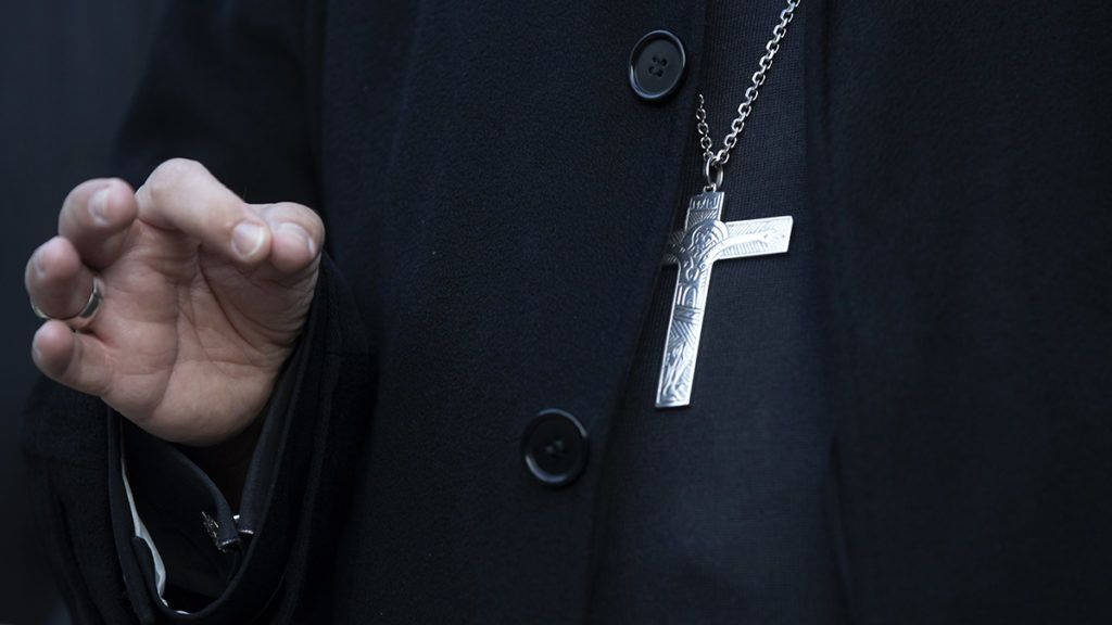 Vatican's top abuse investigator Maltese archbishop Charles Scicluna gestures as he gives a press conference at the Apostolic Nunciature in Santiago on June 19, 2018. - Scicluna and fellow papal envoy Jordi Bertomeu are visiting Chile for a second time to take witness statements from victims of sexual abuse in the church and provide instruction to Chilean dioceses to respond adequately to any new complaints. (Photo by Claudio REYES / AFP)