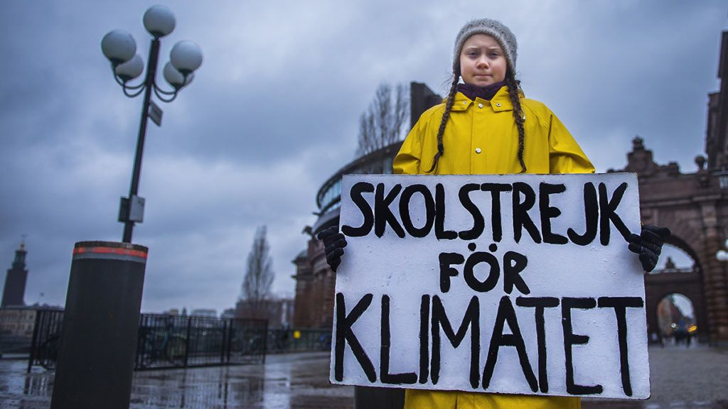 "Swedish 15-year-old girl Greta Thunberg holds a placard reading ""School strike for the climate"" during a protest against climate change outside the Swedish parliament on November 30, 2018. - In more than hundred cities across Sweden, environmentalists have organised protests, partly inspired by Greta Thunberg, who strikes every Friday against climate change outside the parliament since several months. UN's annual climate talks which this year will take place in Poland starts on December 2, 2018. (Photo by Hanna FRANZEN / TT News Agency / AFP) / Sweden OUT"