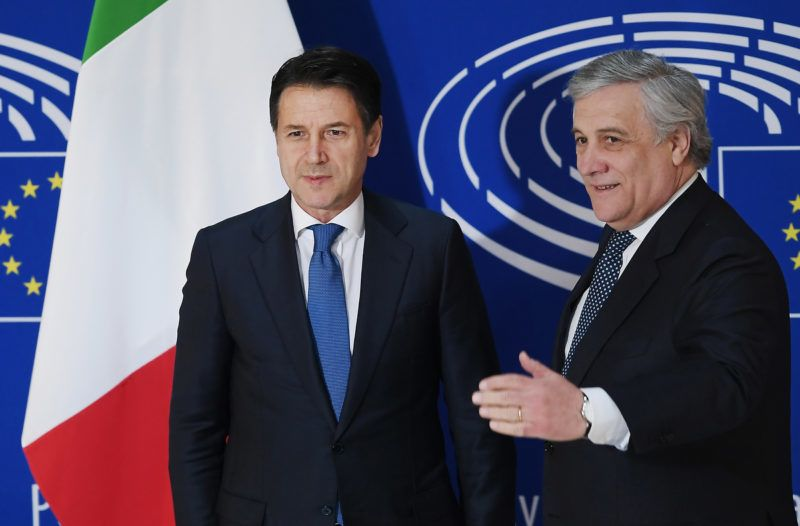 President of the European Parliament Antonio Tajani (R) welcomes Italy's Prime Minister Giuseppe Conte ahead of a debate on the future of Europe at the European Parliament, in Strasbourg, eastern France, on February 12, 2019. (Photo by FREDERICK FLORIN / AFP)