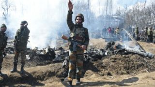 UPDATING CAPTIONIndian soldiers gesture near the remains of an Indian Air Force helicopter after it crashed in Budgam district, outside Srinagar on February 27, 2019. - Officials said an investigation was underway into the cause of the crash, which came as Pakistan claimed to have shot down two Indian fighter jets in the divided and disputed Kashmir region. (Photo by Tauseef MUSTAFA / AFP) / UPDATING CAPTION