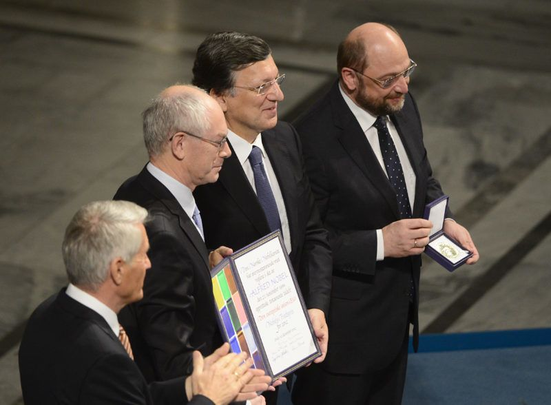(LtoR) Chair of the Norwegian Nobel Committee Torbjorn Jagland applauds European Union (EU) President  Herman Van Rompuy, President of the European Commission Jose Manuel Barroso and President of the European Parliament Martin Schulz who pose after receiving the Nobel Peace Prize during the Nobel Peace Prize awarding ceremony at the City Hall in Oslo on December 10, 2012. The EU collects this year's prestigious Nobel Peace Prize, with the bloc battered and divided by a three-year economic crisis threatening the continent's social stability. AFP PHOTO / JOHN MACDOUGALL (Photo by JOHN MACDOUGALL / AFP)
