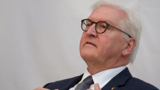 """25 February 2019, Saxony-Anhalt, Halle: Federal President Frank-Walter Steinmeier sits in a round table with the slogan """"You are politics"""". He visited the city on the Saale as part of his project trip """"Democracy very close - Ideas for a lived Basic Law"""". Photo: Sebastian Willnow/dpa-Zentralbild/dpa"""