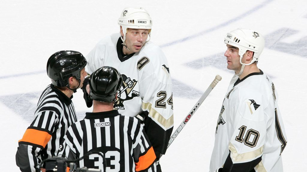 PHILADELPHIA - NOVEMBER 16:  Lyle Odelein #24 and John LeClair #10 of the Pittsburgh Penguins talk with officials after Sidney Crosby left the ice after a heavy check against the Philadelphia Flyers on November 16, 2005 at Wachovia Center in Philadelphia, Pennsylvania. The Penguins defated the Flyers in overtime 3-2.  (Photo by Nick Laham/Getty Images) *** Local Caption *** Lyle Odelein;John LeClair