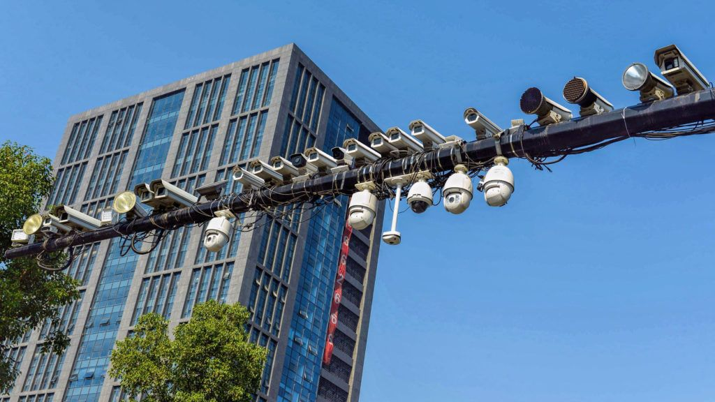 Dozens of surveillance cameras are installed on a beam over a road in Hangzhou city, east China's Zhejiang province, 5 November 2014.