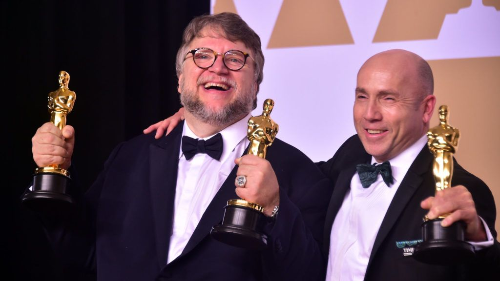 Producer and director Guillermo del Toro (L) and producter J. Miles Dale pose in the press room with the Oscar for best picture and best director for their film The Shape of Water during the 90th Annual Academy Awards on March 4, 2018, in Hollywood, California. (Photo by FREDERIC J. BROWN / AFP)