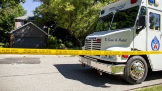 (FILES) In this file photo taken on July 6, 2018 a Toronto Police Command Vehicle sits in front of a home on Mallory Crescent in Toronto, Ontario, where investigators have discovered human remains in connection with accused serial killer Bruce McArthur. - A Canadian landscaper on January 29, 2019 pleaded guilty to the premeditated murders of eight men with links to Toronto's gay community and the mutilation of their bodies, most of them chopped up and hidden in planters.The plea entered by Bruce McArthur, 67, was a surprise -- he had been scheduled to stand trial next year.He now faces the likelihood of life in prison. A sentencing hearing is scheduled to start on February 4. (Photo by Geoff Robins / AFP)