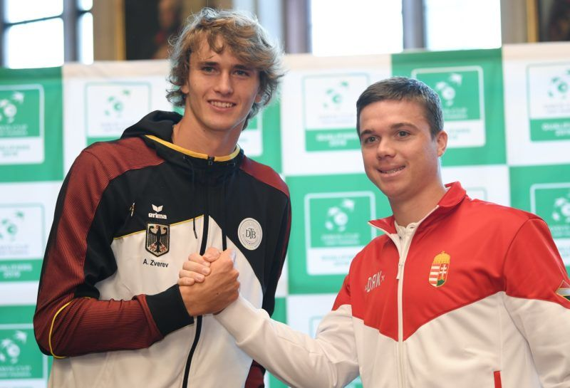 Davis Cup tennis team players, Germany's Alexander Zverev (L) and Hungary's Peter Nagy, pose after the draw for the first round between Germany vs Hungary, in the Emperor Hall of the Roemer medieval building in Frankfurt, western Germany on January 31, 2019. (Photo by Arne Dedert / dpa / AFP) / Germany OUT