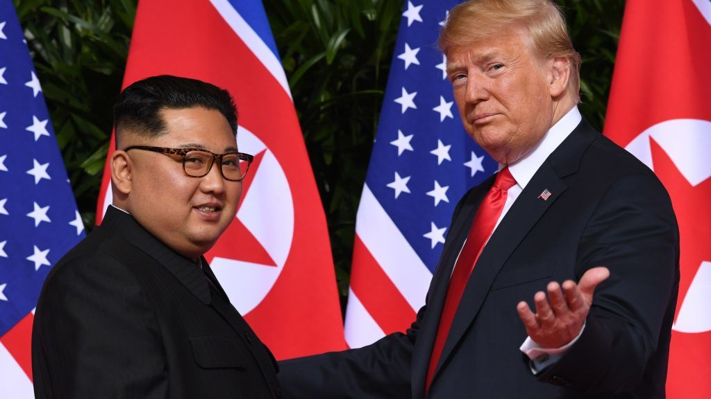 (FILES) In this file photo taken on June 12, 2018 US President Donald Trump (R) meets with North Korea's leader Kim Jong Un (L) at the start of their US-North Korea summit, at the Capella Hotel on Sentosa Island in Singapore. - A US negotiator called on January 31, 2019, on North Korea to provide a detailed account of its weapons to seal a peace deal, saying President Donald Trump was ready to offer a future that includes diplomatic relations and economic aid. Trump is set to hold a second summit with North Korean leader Kim Jong Un in around a month and said Thursday that he would announce the exact date and venue early next week. (Photo by SAUL LOEB / AFP)