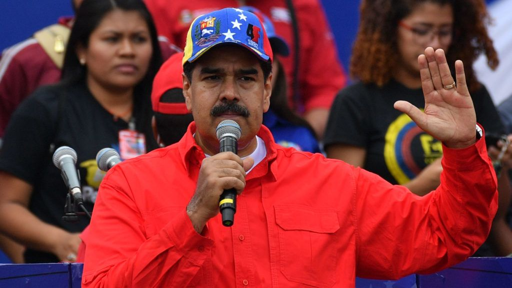 Venezuelan President Nicolas Maduro delivers a speech during a gathering with supporters to mark the 20th anniversary of the rise of power of the late Hugo Chavez, the leftist firebrand who installed a socialist government, in Caracas on February 2, 2019. - Protesters flowed into the streets of Caracas Saturday, with flags and placards, many to support opposition leader Juan Guaido's calls for democratic elections and others to back embattled President Nicolas Maduro. (Photo by Yuri CORTEZ / AFP)