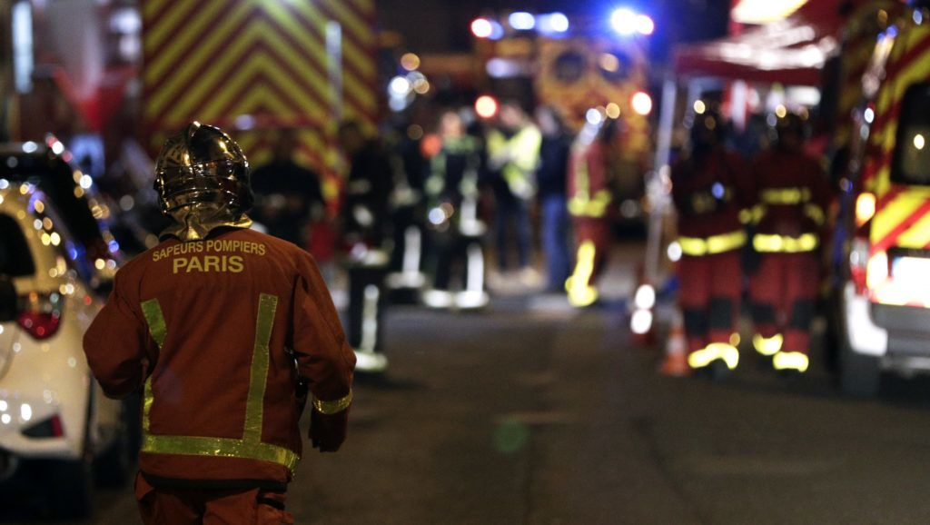 Firefighters are seen near a building that caught fire in the 16th arrondissement in Paris, on February 5, 2019. - Seven people died and another was seriously injured in a building fire in a wealthy Paris neighbourhood on Monday night, the fire service said. The blaze, which took hold in an eight-storey block in the French capital's trendy 16th arrondissement, left 24 people, including two firefighters, with minor injuries. (Photo by Geoffroy VAN DER HASSELT / AFP)