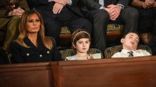 US First lady Melania Trump (L) with Grace Eline and Joshua Trump, special guests of President Donald Trump, look during of the State of the Union address at the US Capitol on February 5, 2019 in Washington, DC. (Photo by MANDEL NGAN / AFP)