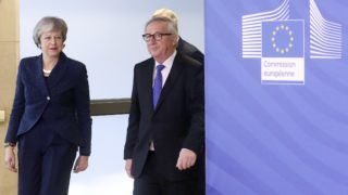 British Prime Minister Theresa May (L) is welcomed by European commission President Jean-Claude Juncker (R) ahead to a meeting on Brexit, on February 7, 2019 in Brussels. (Photo by François WALSCHAERTS / AFP)